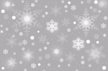 Снежинки на сером фоне.