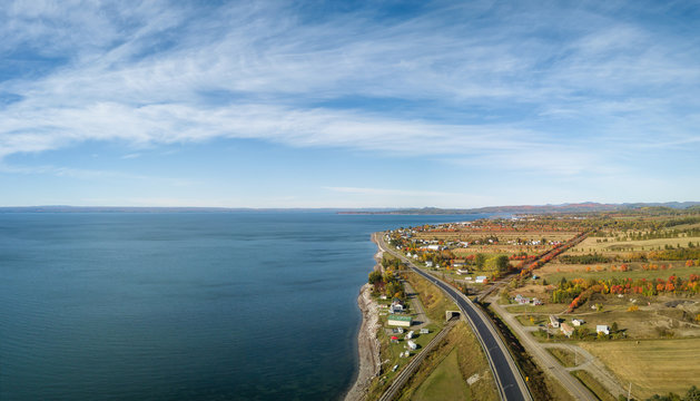 Aerial panoramic view of the Atlantic Ocean Coast during a sunny morning. Taken near Carleton, Quebec, Canada.