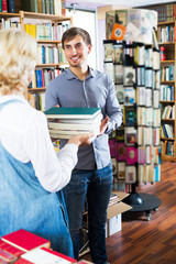 Man and woman holding books