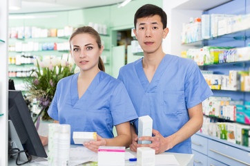 Female and male specialist are attentively stocktaking medicines