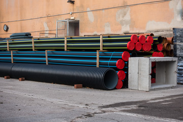 Stack of plastic pipes and prefabricated wells for road works
