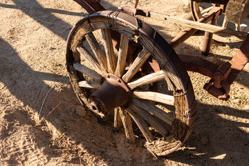 Antique old wagon wheel in the desert