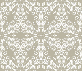 Floral vector ornament. Seamless abstract classic background with flowers. Pattern with repeating floral elements. Ornament for fabric, wallpaper and packaging