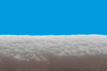 snow surface close-up on blue background