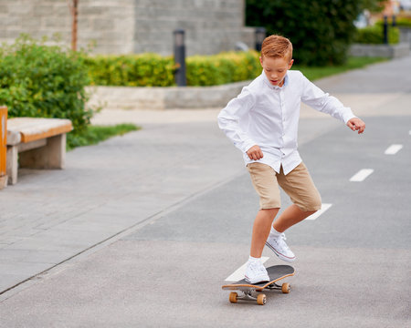 Boy Ride Skateboard in City Street. Urban Summer Lifestyle