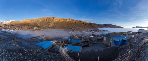 Gryz village covers the icy fog
