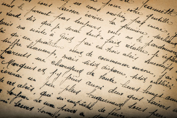 Old unreadable handwritten text aged paper texture background