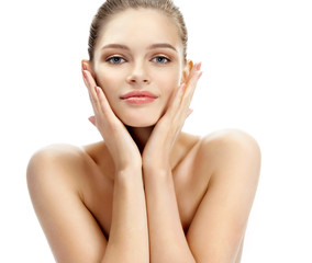 Young woman touching her clean skin. Photo of blonde model on white background. Skin care concept