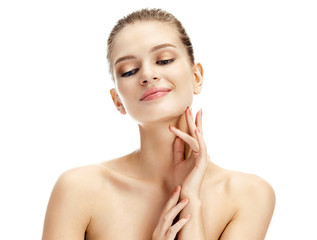 Sensual woman touching her face on white background. Youth and skin care concept