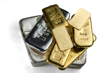Several cast and minted gold bars and silver cast bars isolated on white background. Selective focus.