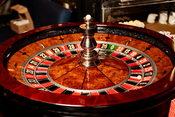 Casino theme. Golden roulette wheel closeup