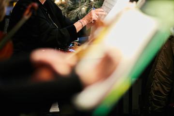 conert violinist taking notes on sheet music