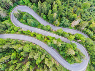 View from above of a forest curvy road