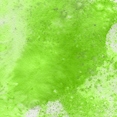 Green watercolor bright texture. Abstract washes and brush strokes on the white paper background.