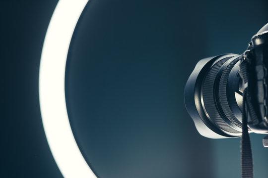 Camera lens and LED ring light in studio