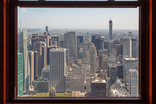 NEW YORK CITY, NY - AUGUST 09, 2014: View of Manhattan New York City Skyline Buildings from High Rise Window