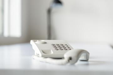 White landline telephone with handset off line