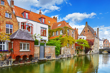 Wall Murals Bridges Bruges, Belgium. Medieval vintage brick houses with balconies