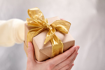 hands holding craft gift box