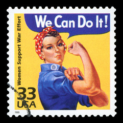 UNITED STATES CIRCA 1999 : Canceled USA. postage stamp showing an image of Rosie The Riveter commemorating the American woman who worked in factories during the World War II, circa 1999.