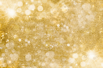 Gold glitter background. Golden bright, warm light flares and mist