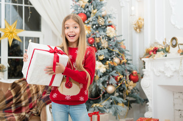xmas online shopping. Family holiday. Happy new year. Winter. The morning before Xmas. Little girl. Christmas tree and presents. Child enjoy the holiday. Holiday atmosphere