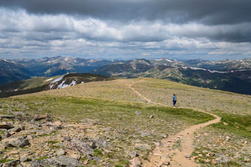 Woman hiking trail on Berthoud Pass Trail in Colorado