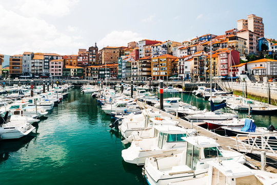 Moored boats and buildings on the waterfront of Bermeo, Spain