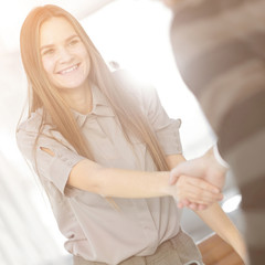 close up. the handshake of employee and customer in a modern office