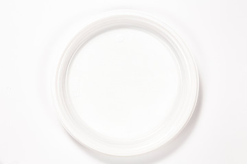 White empty plastic plate isolated on white background