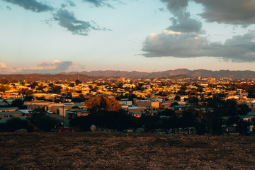 Town with mountains in the distance at sunset