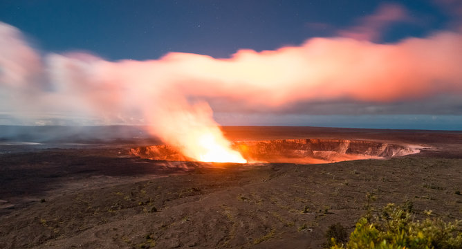 Fire and smoke rise from a volcano