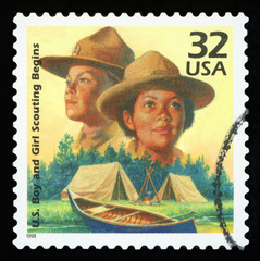 UNITED STATES OF AMERICA - CIRCA 1998: A stamp printed in USA shows Boy Scouts started in 1910, Girl Scouts formed in 1912, series Celebrate the Century, 1910s, circa 1998
