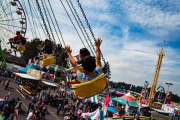 Children on a merry go round ride