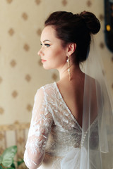 morning of the bride, a beautiful woman in a white dress is preparing for the wedding