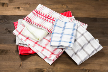 Different checkered tableclothes isolated on wooden background