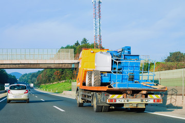 Mobile crane on highway road in Slovenia