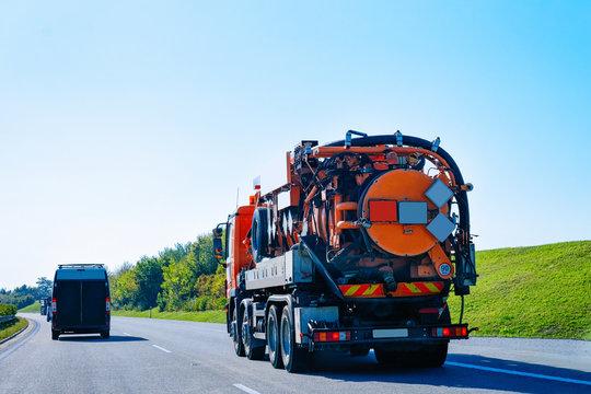 Vacuum waste cistern truck on highway road in Slovenia