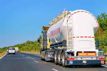 White Tanker storage truck on asphalt highway Poland