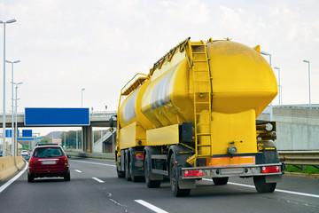 Yellow Tanker storage truck on asphalt highway Poland
