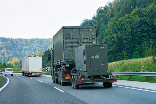Military truck carrying trailer in road of Slovenia