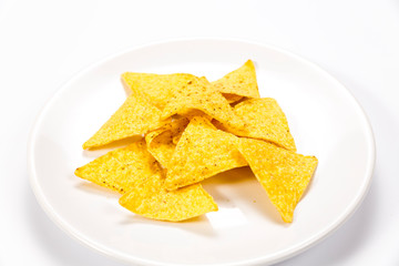 Crispy nachos on a plate isolated on white background