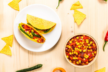 Stuffed colorful burritos on a wooden background