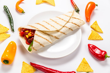 Stuffed colorful tortilla on a white background