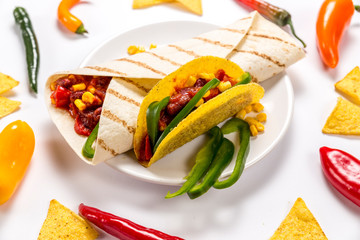 Stuffed colorful tortilla and a burrito on a white background