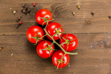 Bunch of tomatoes on a wooden background
