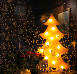 Christmas showcase. Ornament and lamp tree in a cafe