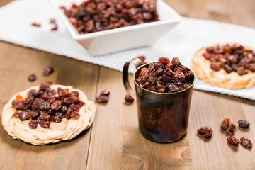 Organic dried raisins on a wooden background