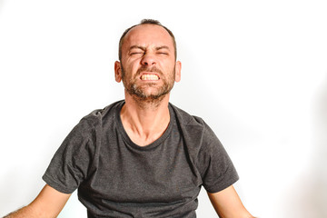 Man in studio with effort face, model expressions isolating white background