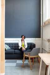 Asian Businesswoman portrait on couch in modern office